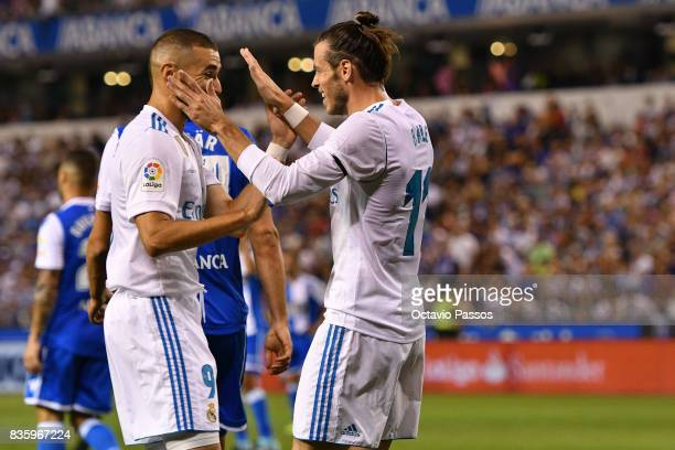 Gareth Bale of Real Madrid scores the first goal and celebrates whit teammates during the La Liga match between Deportivo La Coruna and Real Madrid...