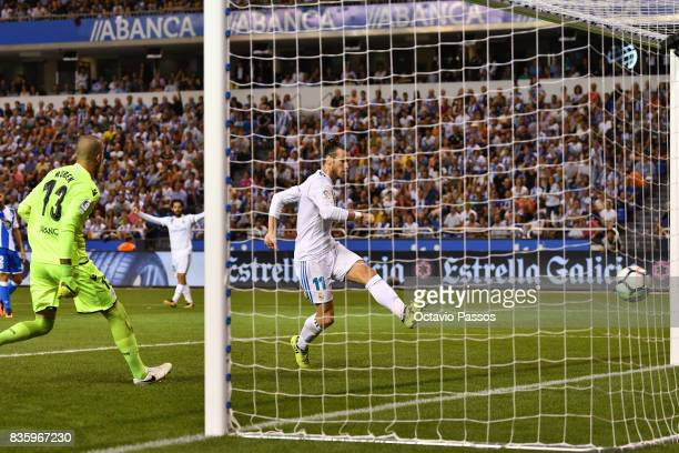 Gareth Bale of Real Madrid scores the first goal during the La Liga match between Deportivo La Coruna and Real Madrid at Riazor Stadium on August 20...
