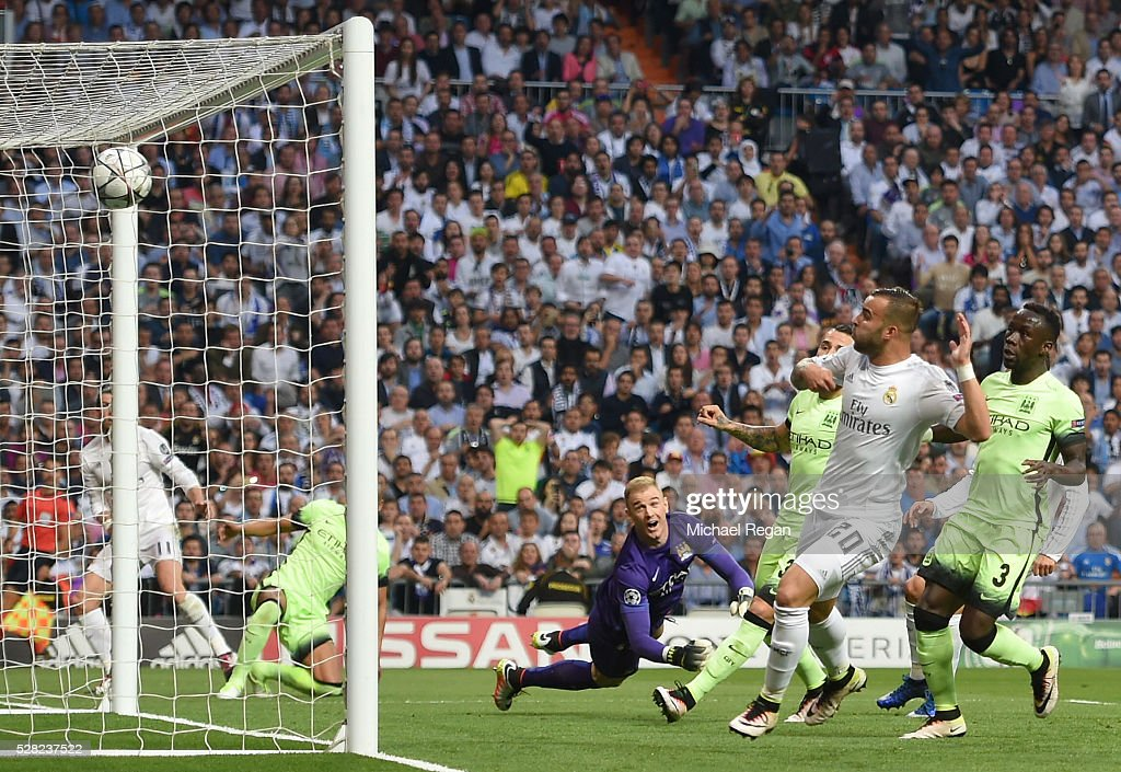<a gi-track='captionPersonalityLinkClicked' href=/galleries/search?phrase=Gareth+Bale&family=editorial&specificpeople=609290 ng-click='$event.stopPropagation()'>Gareth Bale</a> of Real Madrid (obscured) scores the opening goal during the UEFA Champions League semi final, second leg match between Real Madrid and Manchester City FC at Estadio Santiago Bernabeu on May 4, 2016 in Madrid, Spain.
