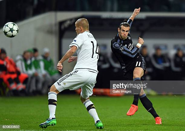 Gareth Bale of Real Madrid scores the team's first goal during the Group Stage of the UEFA Champions League match between Legia Warszawa and Real...