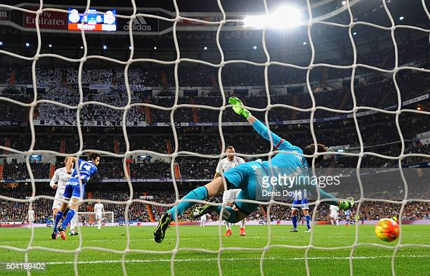 Gareth Bale of Real Madrid scores their second goal past goalkeeper German Lux of Deportivo La Coruna during the La Liga match between Real Madrid CF...