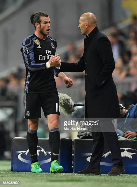 Gareth Bale of Real Madrid shakes hand with head coach Zinedine Zidane of Real Madrid during the UEFA Champions League Quarter Final first leg match...