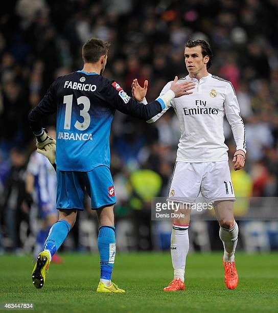 Gareth Bale of Real Madrid shakes hands with Fabricio Agosto of RC Deportivo La Coruna at the end of the La Liga match between Real Madrid CF and RC...