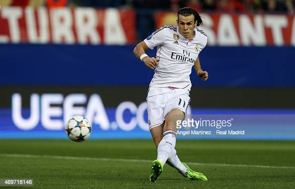 Gareth Bale of Real Madrid shoots on goal during the UEFA Champions League Quarter Final first leg match between Club Atletico de Madrid and Real...