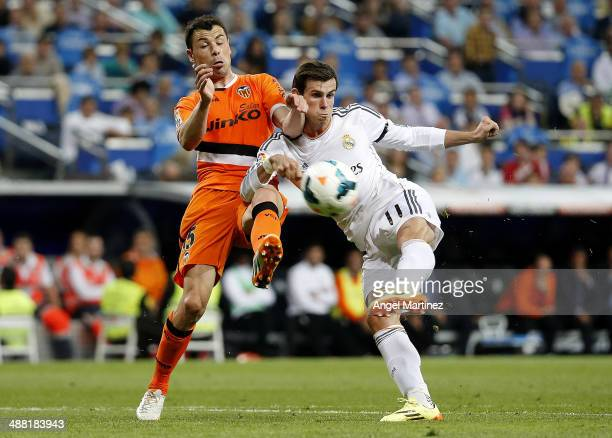 Gareth Bale of Real Madrid shoots on goal under pressure from Javier Fuego of Valencia CF during the La Liga match between Real Madrid and Valencia...