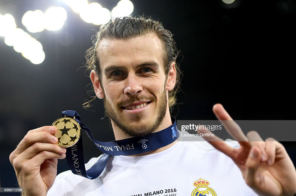 <a gi-track='captionPersonalityLinkClicked' href=/galleries/search?phrase=Gareth+Bale&family=editorial&specificpeople=609290 ng-click='$event.stopPropagation()'>Gareth Bale</a> of Real Madrid shows his winners medal after the UEFA Champions League Final match between Real Madrid and Club Atletico de Madrid at Stadio Giuseppe Meazza on May 28, 2016 in Milan, Italy.