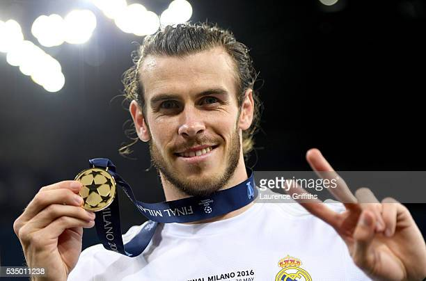 Gareth Bale of Real Madrid shows his winners medal after the UEFA Champions League Final match between Real Madrid and Club Atletico de Madrid at...