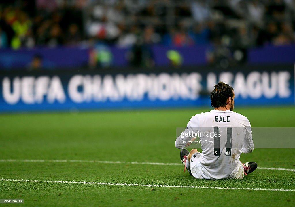 <a gi-track='captionPersonalityLinkClicked' href=/galleries/search?phrase=Gareth+Bale&family=editorial&specificpeople=609290 ng-click='$event.stopPropagation()'>Gareth Bale</a> of Real Madrid sits on the pitch during the UEFA Champions League Final match between Real Madrid and Club Atletico de Madrid at Stadio Giuseppe Meazza on May 28, 2016 in Milan, Italy.