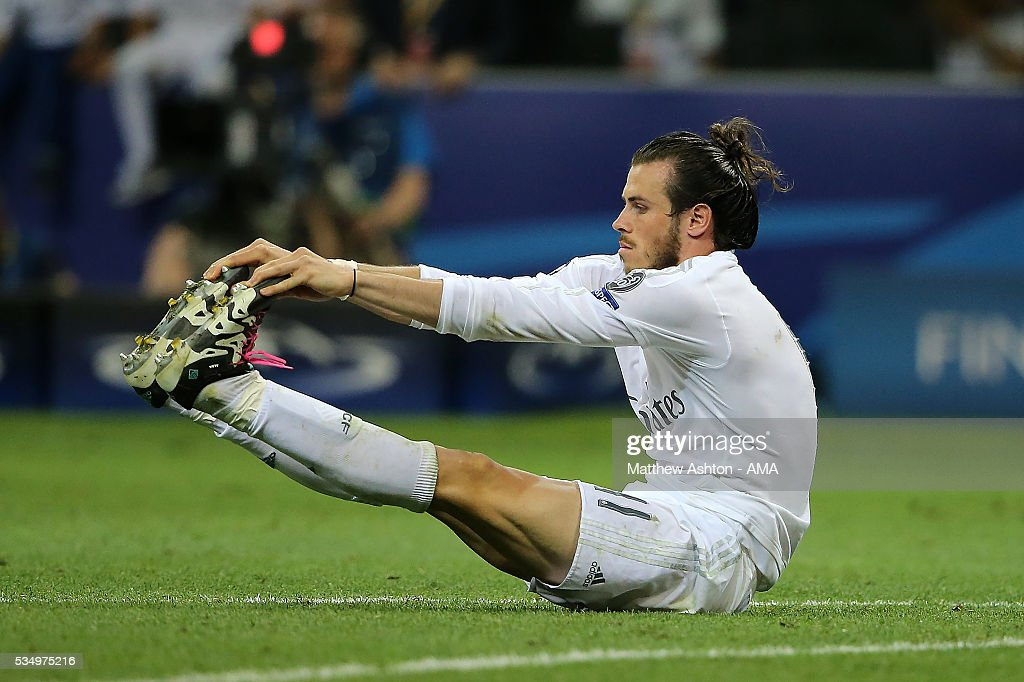 <a gi-track='captionPersonalityLinkClicked' href=/galleries/search?phrase=Gareth+Bale&family=editorial&specificpeople=609290 ng-click='$event.stopPropagation()'>Gareth Bale</a> of Real Madrid stretches during the UEFA Champions League final match between Real Madrid and Club Atletico de Madrid at Stadio Giuseppe Meazza on May 28, 2016 in Milan, Italy.