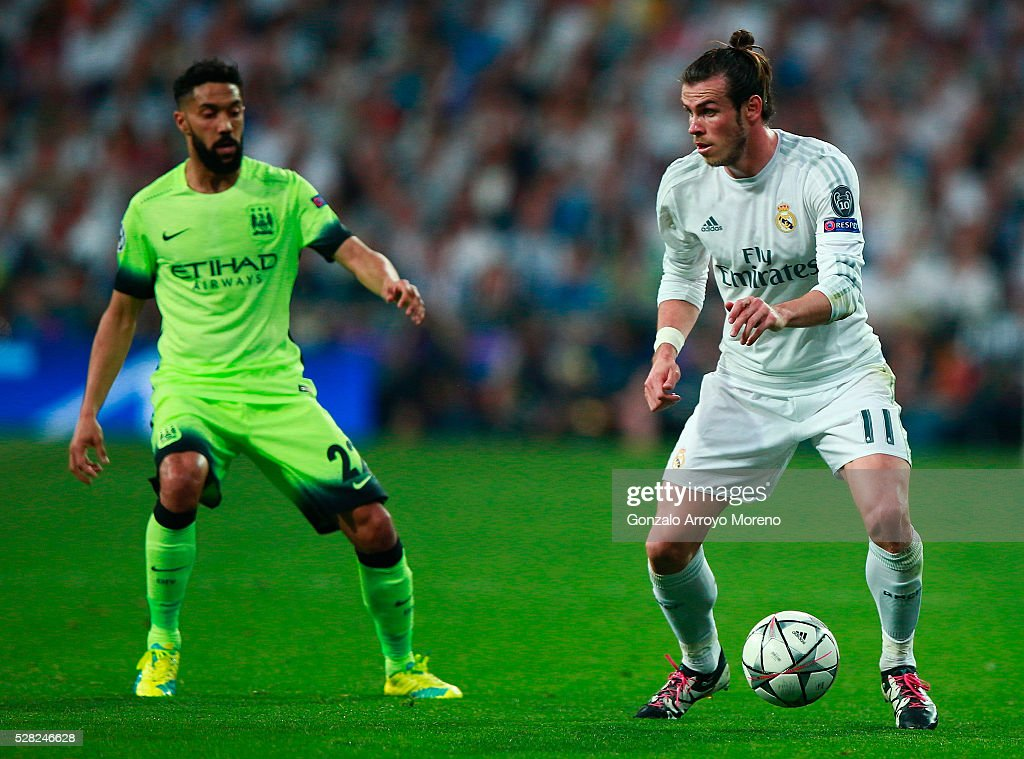 <a gi-track='captionPersonalityLinkClicked' href=/galleries/search?phrase=Gareth+Bale&family=editorial&specificpeople=609290 ng-click='$event.stopPropagation()'>Gareth Bale</a> of Real Madrid takes on <a gi-track='captionPersonalityLinkClicked' href=/galleries/search?phrase=Gael+Clichy&family=editorial&specificpeople=214646 ng-click='$event.stopPropagation()'>Gael Clichy</a> of Manchester City during the UEFA Champions League semi final, second leg match between Real Madrid and Manchester City FC at Estadio Santiago Bernabeu on May 4, 2016 in Madrid, Spain.