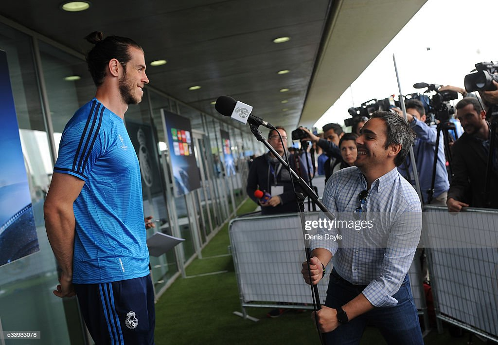 <a gi-track='captionPersonalityLinkClicked' href=/galleries/search?phrase=Gareth+Bale&family=editorial&specificpeople=609290 ng-click='$event.stopPropagation()'>Gareth Bale</a> of Real Madrid talks to members of the press at the mixed zone after the team training session at the Real Madrid Open Media Day ahead of the UEFA Champions League Final against Club Atletico Madrid at Valdebebas training ground on May 24, 2016 in Madrid, Spain.