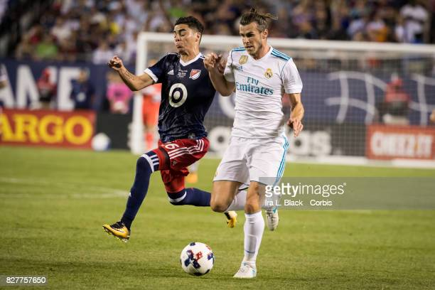Gareth Bale of Real Madrid tangles it out with Miguel Almiron of the MLS AllStar team during the MLS AllStar match between the MLS AllStars and Real...