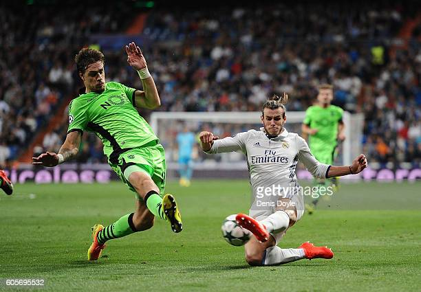 Gareth Bale of Real Madrid tries to cross the ball while being challenged by Sebastian Coates of Sporting Clube de Portugal during the UEFA Champions...
