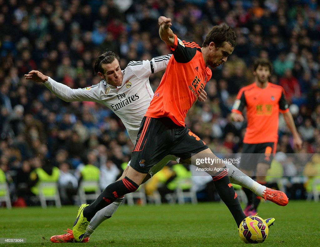 Gareth Bale of Real Madrid vies for ball with Real Sociedad's Mikel Gonzalez during the La Liga soccer match between Real Madrid CF and Real Sociedad...