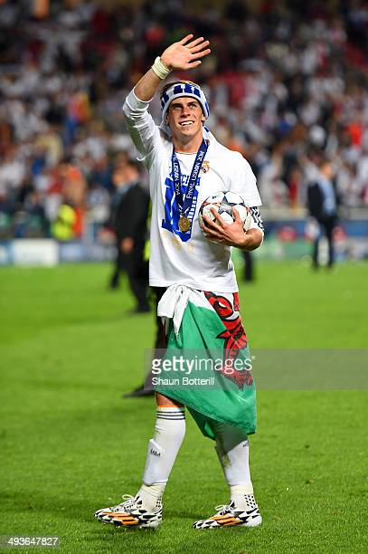 Gareth Bale of Real Madrid waves to the fans after victory during the UEFA Champions League Final between Real Madrid and Atletico de Madrid at...