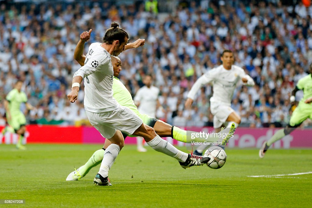 <a gi-track='captionPersonalityLinkClicked' href=/galleries/search?phrase=Gareth+Bale&family=editorial&specificpeople=609290 ng-click='$event.stopPropagation()'>Gareth Bale</a> of Real Madrid's shot is deflected for the opening goal during the UEFA Champions League Semi Final second leg match between Real Madrid and Manchester City FC at Estadio Santiago Bernabeu on May 4, 2016 in Madrid, Spain.