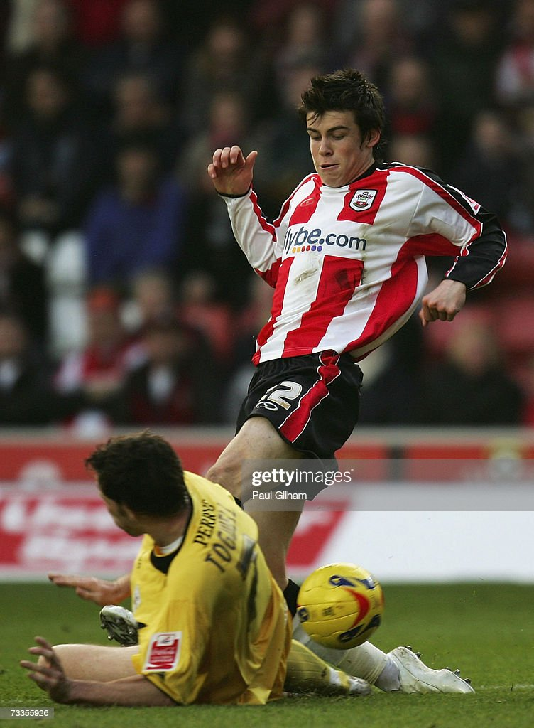 Gareth Bale of Southampton battles for the ball with Sam Togwell of Barnsley during the Coca-Cola Championship match between Southampton and Barnsley at St Mary's Stadium on February 17, 2007 in Southampton, England.