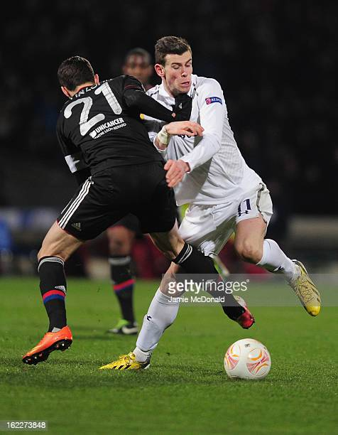 Gareth Bale of Spurs battles with Maxime Gonalons of Olympique Lyonnais during the UEFA Europa League Round of 32 second leg match between Olympique...