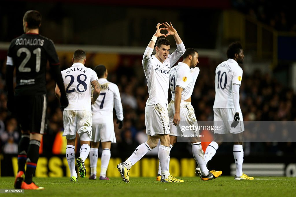 <a gi-track='captionPersonalityLinkClicked' href=/galleries/search?phrase=Gareth+Bale&family=editorial&specificpeople=609290 ng-click='$event.stopPropagation()'>Gareth Bale</a> of Spurs celebrates after scoring the opening goal from a free kick during the UEFA Europa League round of 32 first leg match between Tottenham Hotspur and Olympique Lyonnais at White Hart Lane on February 14, 2013 in London, England.