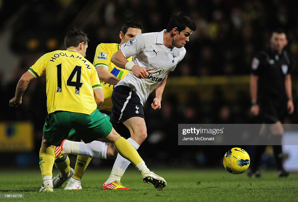 Gareth Bale of Spurs evades a tackle from Wesley Hoolahan of Norwich City during the Barclays Premier Leauge match between Norwich City and Tottenham Hotspur at Carrow Road on December 27, 2011 in Norwich, England.