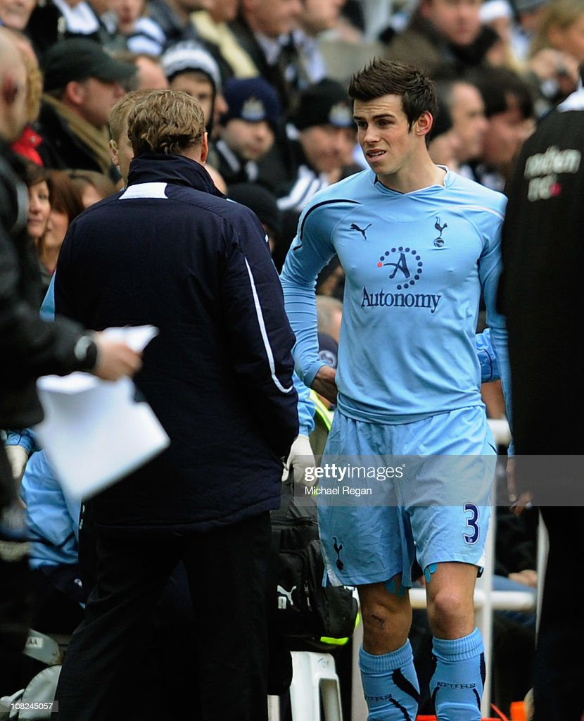 Gareth Bale of Spurs goes off injured during the Barclays Premier League match between Newcastle United and Tottenham Hotspur at St James' Park on January 22, 2011 in Newcastle upon Tyne, England.