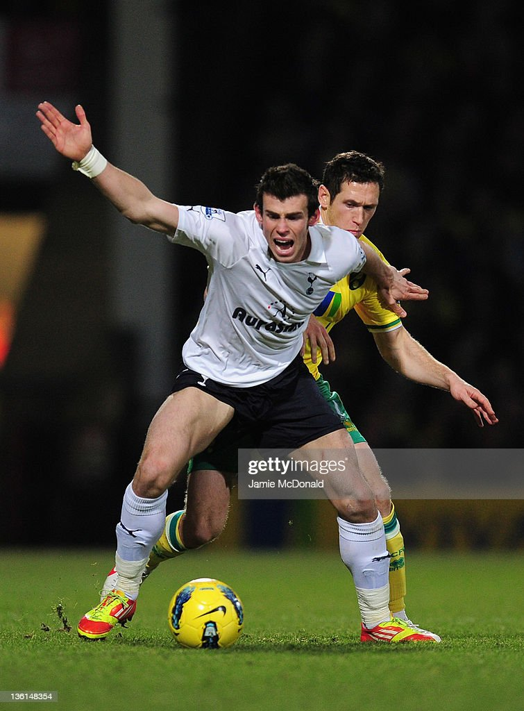 Gareth Bale of Spurs holds off a challenge from Andrew Crofts of Norwich City during the Barclays Premier Leauge match between Norwich City and Tottenham Hotspur at Carrow Road on December 27, 2011 in Norwich, England.