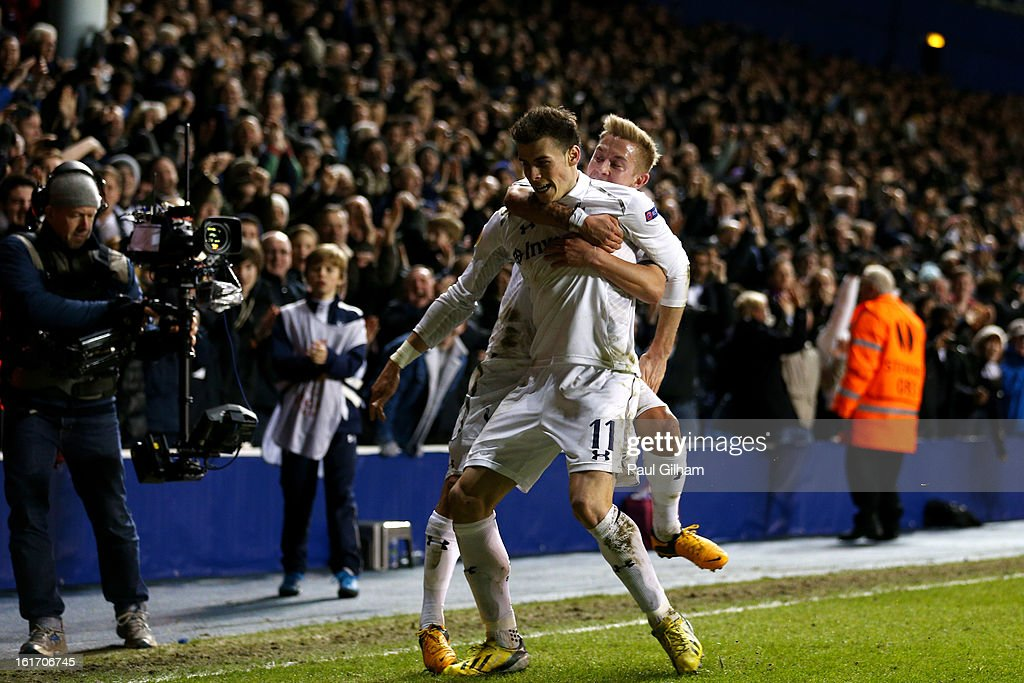 Gareth Bale of Spurs is congratulated by teammate Lewis Holtby (R) after scoring his team's match winning second goal from a free kick during the UEFA Europa League round of 32 first leg match between Tottenham Hotspur and Olympique Lyonnais at White Hart Lane on February 14, 2013 in London, England.