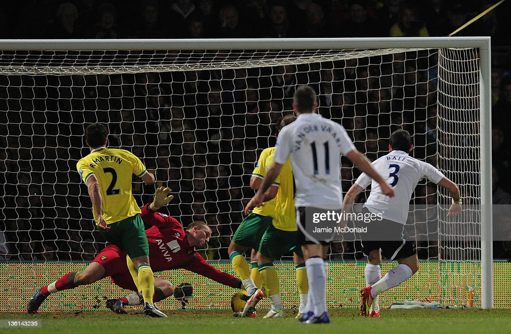 Gareth Bale of Spurs scores the opening goal past John Ruddy of Norwich City during the Barclays Premier Leauge match between Norwich City and Tottenham Hotspur at Carrow Road on December 27, 2011 in Norwich, England.