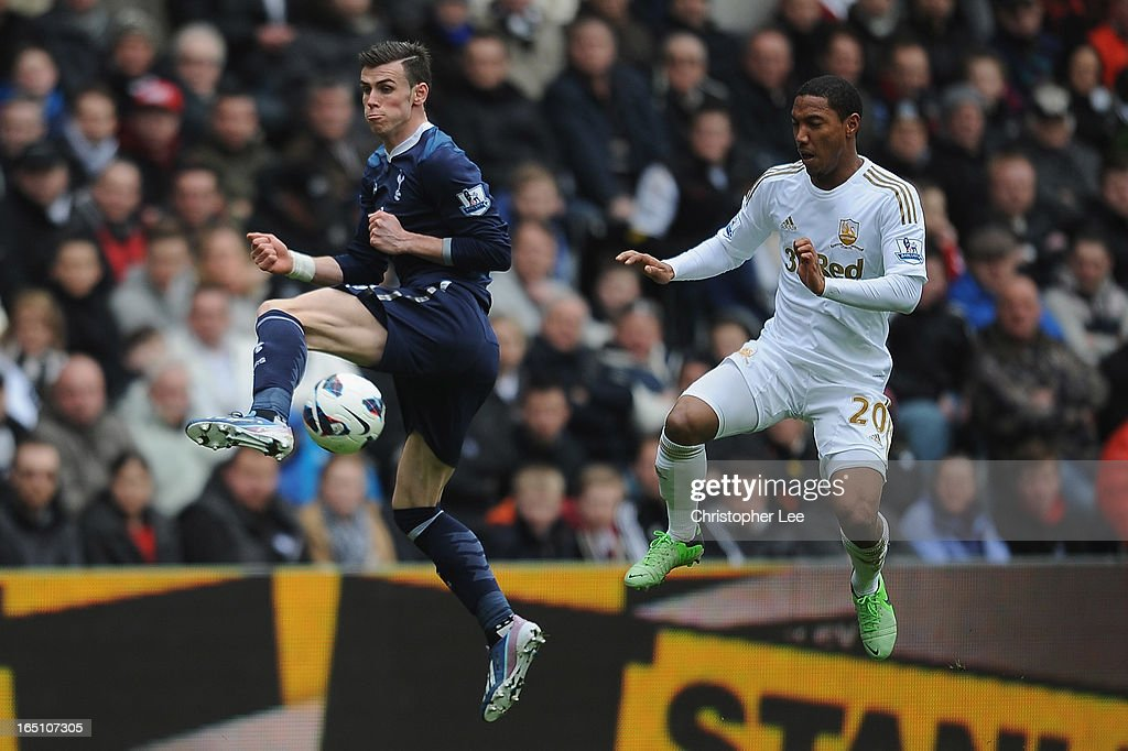 <a gi-track='captionPersonalityLinkClicked' href=/galleries/search?phrase=Gareth+Bale&family=editorial&specificpeople=609290 ng-click='$event.stopPropagation()'>Gareth Bale</a> of Spurs tips the ball past <a gi-track='captionPersonalityLinkClicked' href=/galleries/search?phrase=Jonathan+de+Guzman&family=editorial&specificpeople=674543 ng-click='$event.stopPropagation()'>Jonathan de Guzman</a> of Swansea with his heel during the Barclays Premier League match between Swansea City and Tottenham Hotspur at Liberty Stadium on March 30, 2013 in Swansea, Wales.