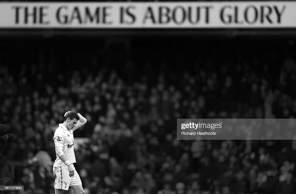 <a gi-track='captionPersonalityLinkClicked' href=/galleries/search?phrase=Gareth+Bale&family=editorial&specificpeople=609290 ng-click='$event.stopPropagation()'>Gareth Bale</a> of Tottenham applaudes the fans at the final whistle during the Barclay's Premier League match between Tottenham Hotspur and Newcastle United at White Hart Lane on February 9, 2013 in London, England.