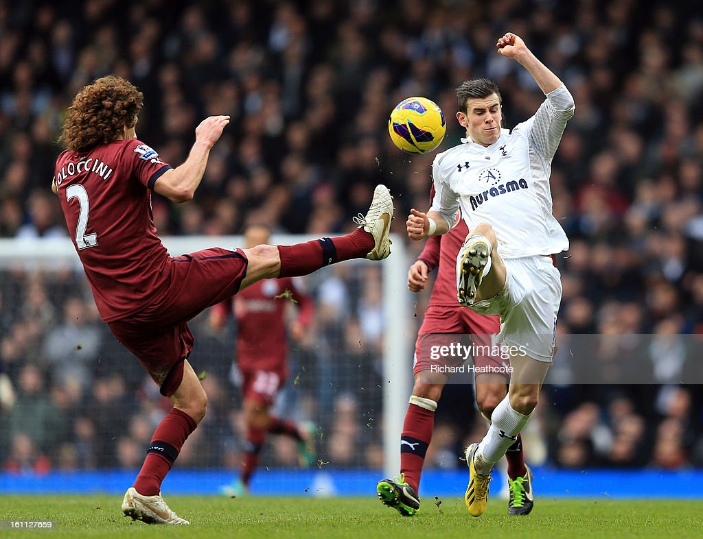 <a gi-track='captionPersonalityLinkClicked' href=/galleries/search?phrase=Gareth+Bale&family=editorial&specificpeople=609290 ng-click='$event.stopPropagation()'>Gareth Bale</a> of Tottenham beats Fabrizio Coloccini of Newcastle to the ball and runs on to score the winning goal during the Barclay's Premier League match between Tottenham Hotspur and Newcastle United at White Hart Lane on February 9, 2013 in London, England.