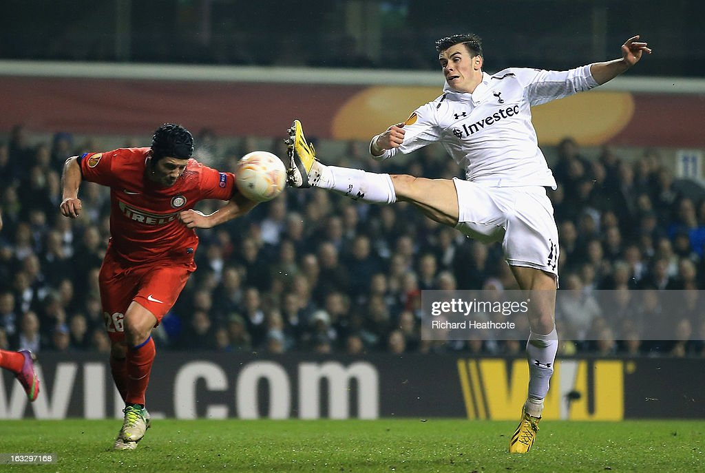 Gareth Bale of Tottenham Hotspur attempts to control the ball as Cristian Chivu of FC Internazionale Milano closes him down during the UEFA Europa League Round of 16 First Leg match between Tottenham Hotspur and FC Internazionale Milano at White Hart Lane on March 7, 2013 in London, England.
