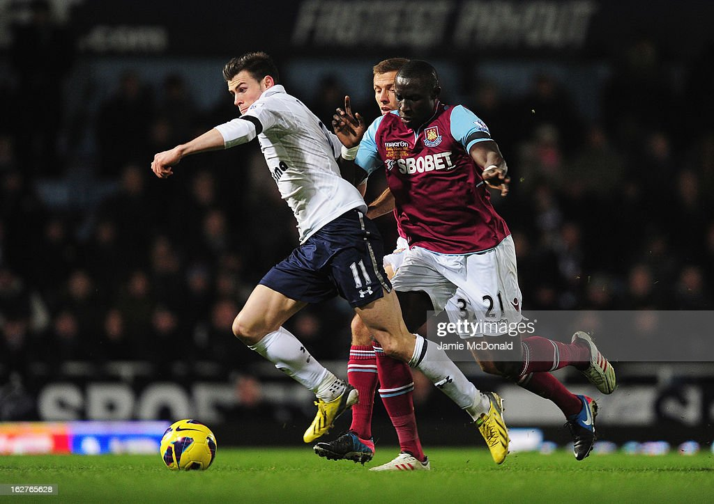 Gareth Bale of Tottenham Hotspur bursts past Mohamed Diame of West Ham United during the Barclays Premier League match between West Ham United and Tottenham Hotspur at the Boleyn Ground on February 25, 2013 in London, England.
