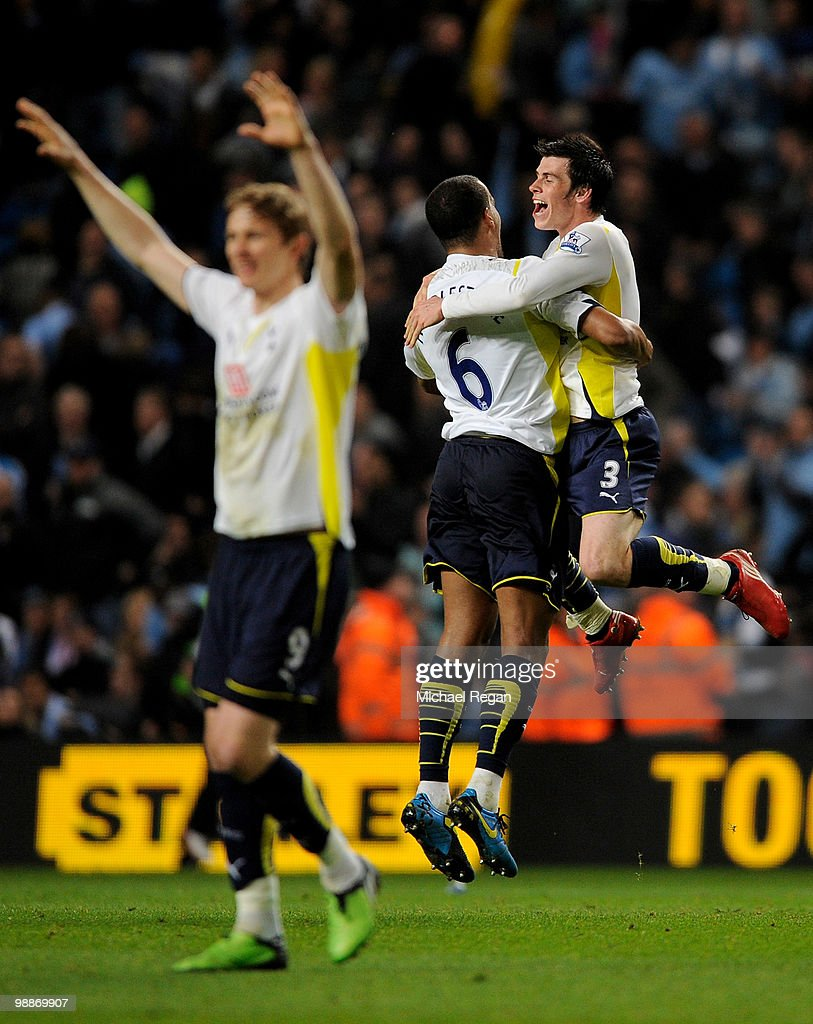 Gareth Bale of Tottenham Hotspur celebrates with team mate Tom Huddlestone at the end of the Barclays Premier League match between Manchester City and Tottenham Hotspur at the City of Manchester Stadium on May 5, 2010 in Manchester, England.