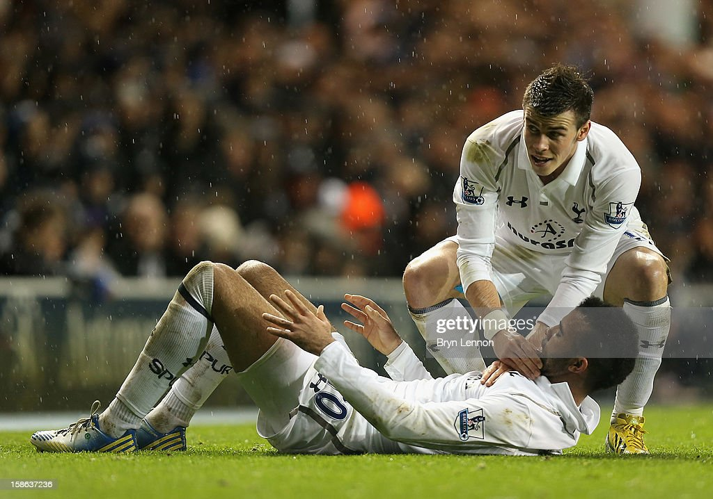 <a gi-track='captionPersonalityLinkClicked' href=/galleries/search?phrase=Gareth+Bale&family=editorial&specificpeople=609290 ng-click='$event.stopPropagation()'>Gareth Bale</a> of Tottenham Hotspur checks the injury of team mate Sandro during the Barclays Premier League match between Tottenham Hotspur and Stoke City at White Hart Lane on December 22, 2012 in London, England.
