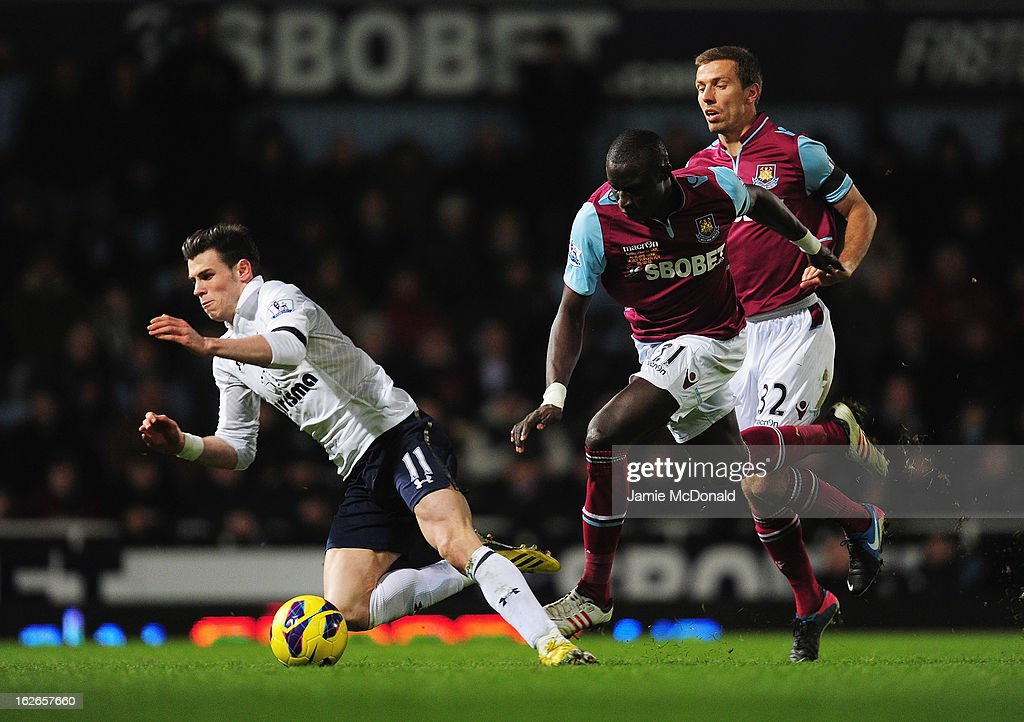 Gareth Bale of Tottenham Hotspur goes to ground under a challenge from Mohamed Diame and Gary O'Neil (R) of West Ham United during the Barclays Premier League match between West Ham United and Tottenham Hotspur at the Boleyn Ground on February 25, 2013 in London, England.