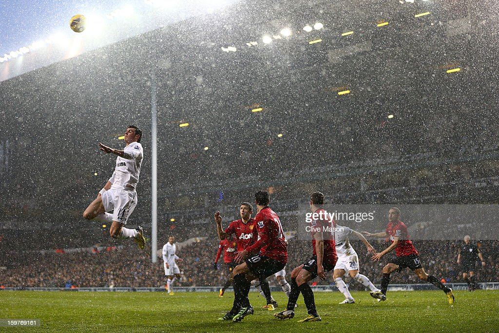 Gareth Bale of Tottenham Hotspur jumps for the cross during the Barclays Premier League match between Tottenham Hotspur and Manchester United at White Hart Lane on January 20, 2013 in London, England.