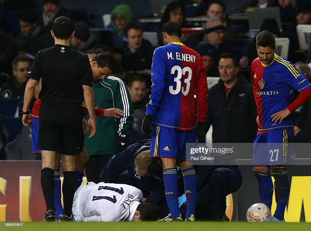 Gareth Bale of Tottenham Hotspur receives treatment as he lies injured on the pitch during the UEFA Europa League quarter-final first leg between Tottenham Hotspur FC and FC Basel 1893 at White Hart Lane on April 4, 2013 in London, England.