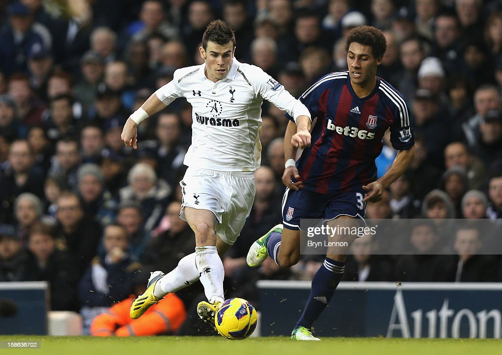 Gareth Bale of Tottenham Hotspur runs with the ball as he is closed down by Ryan Shotton of Stoke City during the Barclays Premier League match between Tottenham Hotspur and Stoke City at White Hart Lane on December 22, 2012 in London, England.