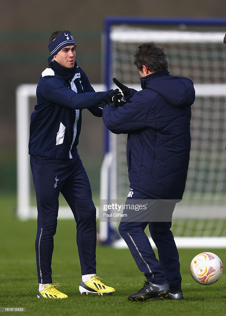 <a gi-track='captionPersonalityLinkClicked' href=/galleries/search?phrase=Gareth+Bale&family=editorial&specificpeople=609290 ng-click='$event.stopPropagation()'>Gareth Bale</a> of Tottenham Hotspur shares a joke with Tottenham Hotspur first team fitness coach Jose Mario Rocha during aTottenham Hotspur training session ahead of thier UEFA Cup round of 32 match against Lyon on February 13, 2013 in Enfield, England.