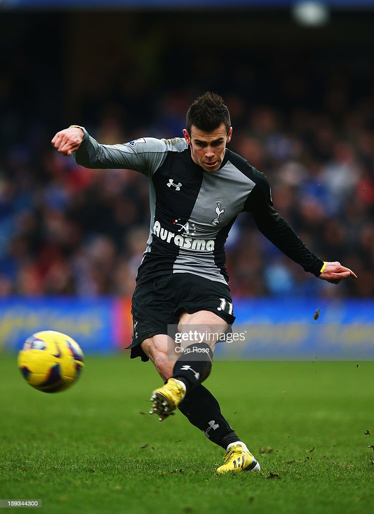 <a gi-track='captionPersonalityLinkClicked' href=/galleries/search?phrase=Gareth+Bale&family=editorial&specificpeople=609290 ng-click='$event.stopPropagation()'>Gareth Bale</a> of Tottenham Hotspur takes a free kick during the Barclays Premier League match between Queens Park Rangers and Tottenham Hotspur at Loftus Road on January 12, 2013 in London, England.