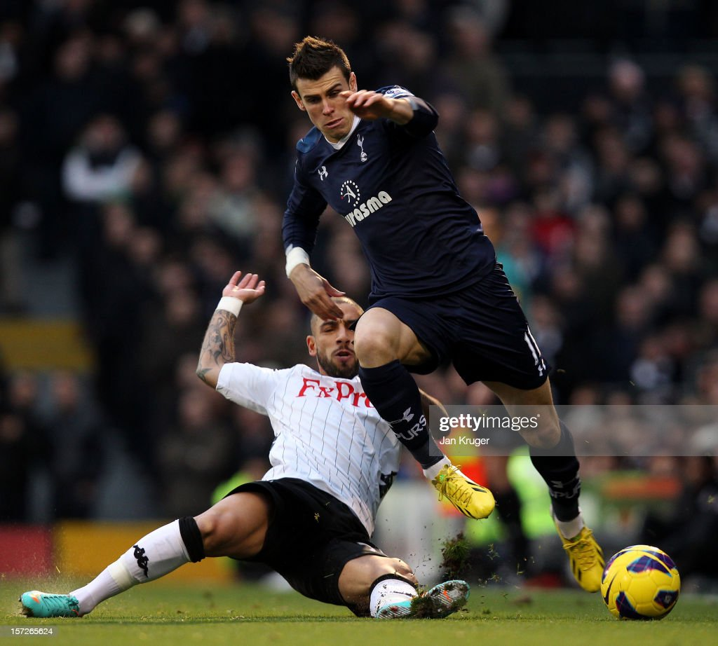 <a gi-track='captionPersonalityLinkClicked' href=/galleries/search?phrase=Gareth+Bale&family=editorial&specificpeople=609290 ng-click='$event.stopPropagation()'>Gareth Bale</a> of Tottenham is tackled by <a gi-track='captionPersonalityLinkClicked' href=/galleries/search?phrase=Ashkan+Dejagah&family=editorial&specificpeople=4024305 ng-click='$event.stopPropagation()'>Ashkan Dejagah</a> of Fulham during the Barclays Premier League match between Fulham and Tottenham Hotspur at Craven Cottage on December 1, 2012 in London, England.