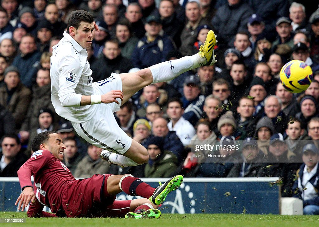Gareth Bale of Tottenham is tackled by James Perch of Newcastle during the Barclays Premier League match between Tottenham Hotspur and Newcastle United at White Hart Lane on February 09, 2013 in London, England.