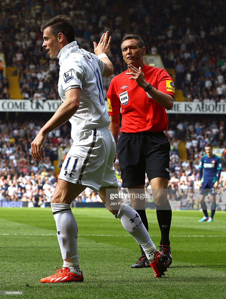 <a gi-track='captionPersonalityLinkClicked' href=/galleries/search?phrase=Gareth+Bale&family=editorial&specificpeople=609290 ng-click='$event.stopPropagation()'>Gareth Bale</a> of Tottenham reacts to a yellow card from referee <a gi-track='captionPersonalityLinkClicked' href=/galleries/search?phrase=Andre+Marriner&family=editorial&specificpeople=221003 ng-click='$event.stopPropagation()'>Andre Marriner</a> for diving during the Barclays Premier League match between Tottenham Hotspur and Sunderland at White Hart Lane on May 19, 2013 in London, England.