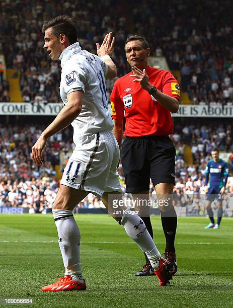 Gareth Bale of Tottenham reacts to a yellow card from referee Andre Marriner for diving during the Barclays Premier League match between Tottenham...