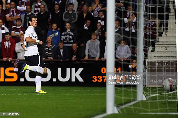 Gareth Bale of Tottenham shoots and scores the fourth goal of the game during the UEFA Europa League Playoff first leg match between Heart of...