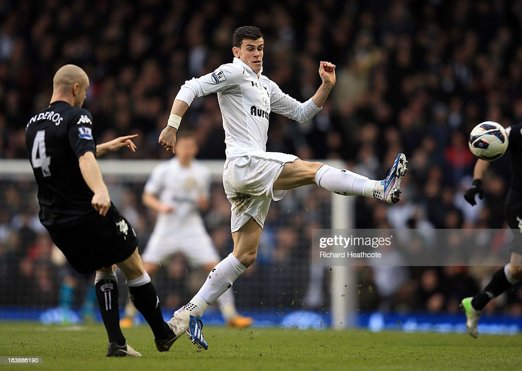 Gareth Bale of Tottenham tries to block a clearance by Philippe Senderos of Fulham during the Barclay's Premier League match between Tottenham Hotspur and Fulham at White Hart Lane on March 17, 2013 in London, England.