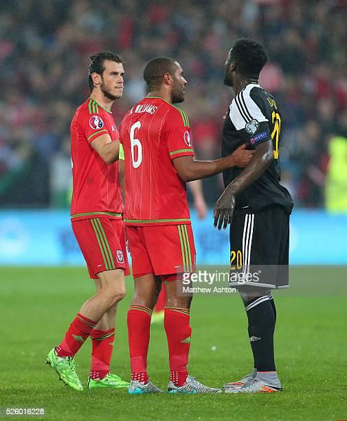 Gareth Bale of Wales and Ashley Williams of Wales console Romelu Lukaku of Belgium