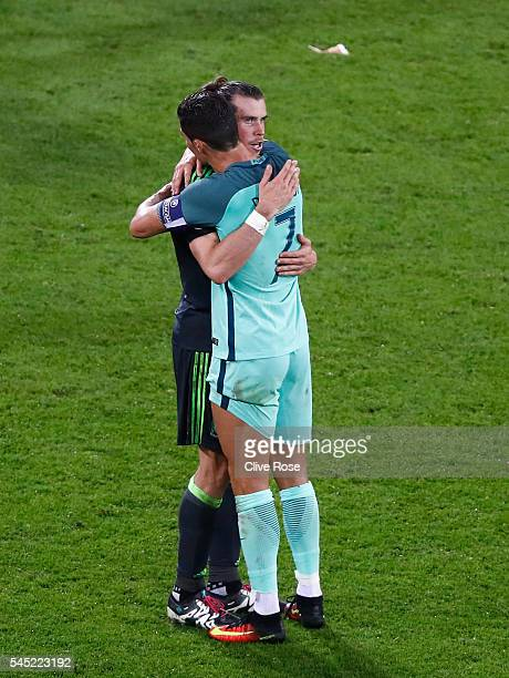 Gareth Bale of Wales and Cristiano Ronaldo of Portugal embrace after the UEFA EURO 2016 semi final match between Portugal and Wales at Stade des...
