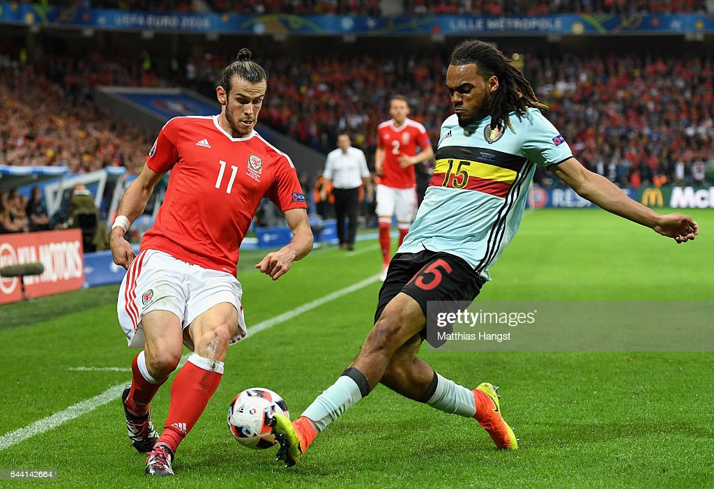 <a gi-track='captionPersonalityLinkClicked' href=/galleries/search?phrase=Gareth+Bale&family=editorial&specificpeople=609290 ng-click='$event.stopPropagation()'>Gareth Bale</a> of Wales and <a gi-track='captionPersonalityLinkClicked' href=/galleries/search?phrase=Jason+Denayer&family=editorial&specificpeople=10953601 ng-click='$event.stopPropagation()'>Jason Denayer</a> of Belgium compete for the ball during the UEFA EURO 2016 quarter final match between Wales and Belgium at Stade Pierre-Mauroy on July 1, 2016 in Lille, France.